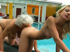 Horny lesbian grannies Candy Lover and Norma have a fun getting intimate under the warm sunshine