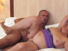 Gigantic and mature Evelin is sucking on her young paramours tasty cock zealously