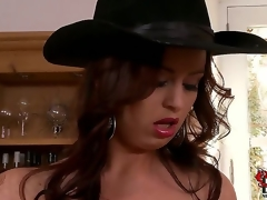 Sirale returns to our site to bedazzle our brains and boners with her jugs. This time the bosomy Czech is in a darksome dress and a cowboy hat as this babe looks on a dining room shelf.