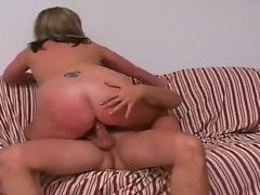 Tall blonde man Jay with sexy body and long rock hard cock receives seduced by full figured blonde cougar Marie with gigantic juicy tits and cheep tattoo on lower back.