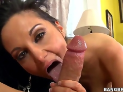 Black haired and arousing milf Ava Addams with large tits gives an astounding blowjob session on the couch after shes done playing with her large dark dildo sex toy int he room.