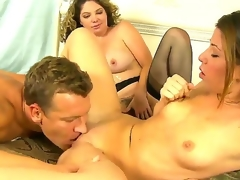 Lusty blonde Kiki Daire and cute Mia Gold with skinny body and small tits suck the same hard meaty dick in this 3some sex with a lusty hunk in their bedroom and have fun