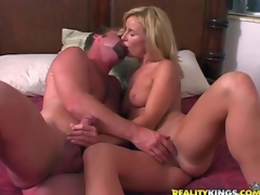 Attractive blonde milf gets her juicy boobies touched by curious man previous to that babe takes off her hot white panties. They warm each other up and then that babe swallows his rock hard cock