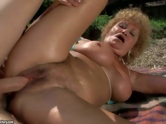 Big breasted oldie Effie enjoys sex with hard dicked youthful stud in nature. Busty granny in barely there bikini top gets her loose muff pounded on the wild beach. She is horny for her youthful paramour