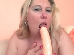 Chubby blonde aged copulates her muff with a toy