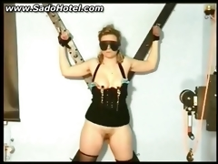Slave tied to a wall gets clamps on her nipps and her love tunnel licked by her master BDSM