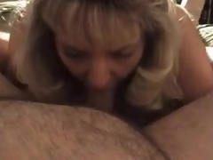 Mature golden-haired wife blows chubby hubby