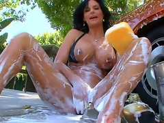 The perverted milf with big tits and big round booty Phoenix Marie is outdoor washing the car and also foaming her own sexy body that is stretched and willing for masturbation