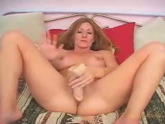 Sexy large breasts milf fucks a dildo