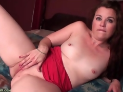 Cute solo mamma with small tits masturbates in sofa