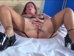 Mature redhead in sexy lingerie masturbates