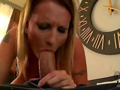 This breasty milf Laura M. is simply unstoppable when it comes to sucking cock! The floozy grabs this fellows fat dick and hungrily gulps it , ready to engulf his balls dry!