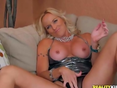 Dani is a perfect bodied golden-haired milf in incredibly sexy short dress. She pulls out her awesome round tits and spreads her legs wide to play with her mature pussy in front of the camera