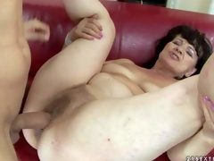 Helena May is s sex obsessed oldie with wet hairy pussy. Naked experienced woman parts her legs on the edge of the couch and gets her vagina drilled by her young hard dicked lover