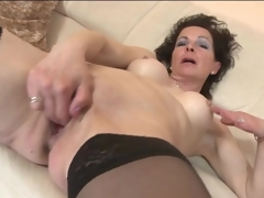 Fingering and toy fucking mature in stockings