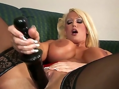 Alura Jenson looks wonderful in these thigh high, jetblack stockings. However, she looks even more excellent with that 14 inch black dildo pounding her pussy, making her D scones bounce.