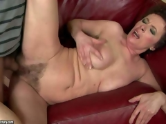 Babuska is a horny oldie that gets her unshaved wet pussy drilled by young hard cock. This aged woman cant get enough. Boy bangs her bush hard on the couch and makes her squirt