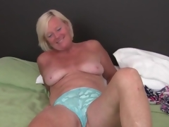 Cute freckled mature blonde masturbates