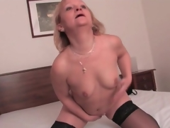 Stout mature blonde in black nylons