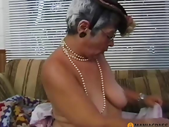 Gray-haired woman sucks dong
