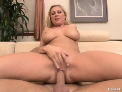 Jumping on top, the gorgeous blonde rides her neighbor's cock with enthusiasm