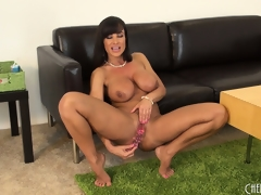 Big-tittied cougar with hawt abs rubs a dildo all over her body