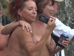 Milfs hanging out topless during Fantasy Fest