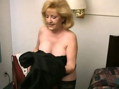 Lustful blonde grandma Kitty Fox stripping and showing her hot decolletage