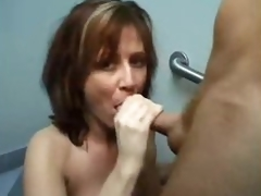 This babe goes into bathroom to suck cock