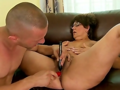 Older slut Gigi M enjoys having her curly cunt drilled by younger man with large ramrod