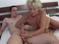 Agw wrinkled golden-haired Malya is naked and ready for sex with young hard dicked guy. That babe gives headjob and then takes his meat pole up her loose experienced pussy. Watch mature slut bounce on hard dick