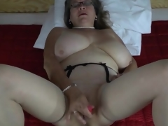 Pearls and glasses on masturbating mature