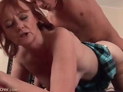 Mature redhead fucked in her hot cunt