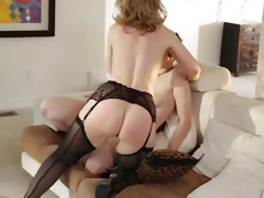 MILF Nina Hartley rides a tomboys strap on cock