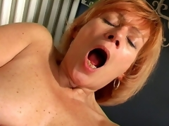 Charming granny Lady spreads cunt and copulates a massive white dildo